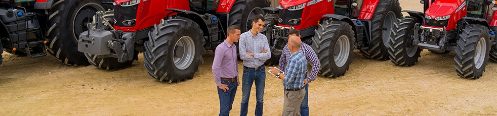 An AGCO dealer shakes hands with one of our valuable customers.